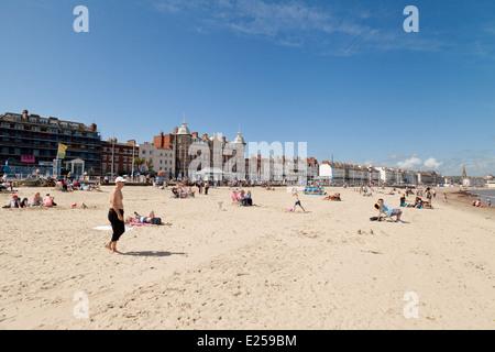 People sunbathing on Weymouth beach, in summer sunshine, Weymouth, Dorset England UK - Stock Photo