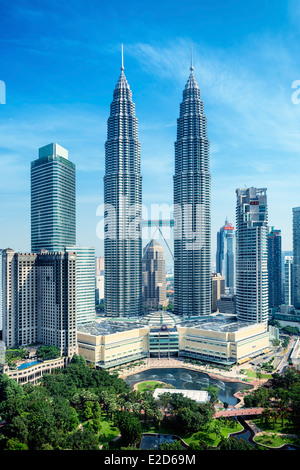 Petronas Towers and KLCC Park in Kuala Lumpur - Stock Photo