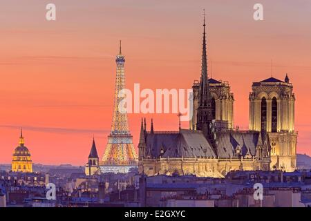 France Paris elevated view of illuminated Eiffel Tower (⌐ SETE illuminations Pierre Bideau) Notre Dame cathedral - Stock Photo