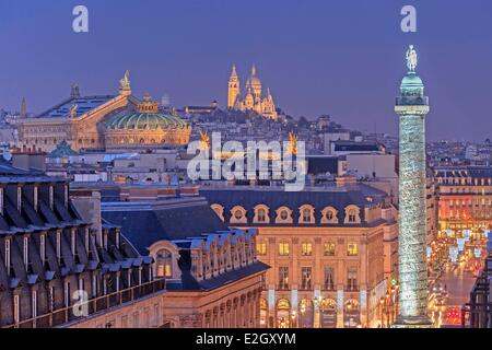 France Paris column of Place Vendomewith Napoleon's statue on top Garnier Opera house and Sacre Coeur basilica illuminated - Stock Photo