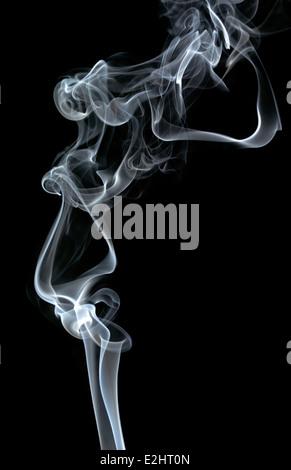PATTERN OF WHITE SMOKE TURBULENCE ON A BLACK BACKGROUND - Stock Photo