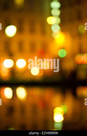 City lights reflected off of river surface - Stock Photo