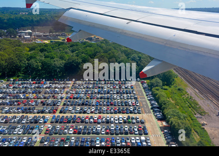 Aerial view of car park airport car parking seen from passenger jet decending towards Gatwick London - Stock Photo