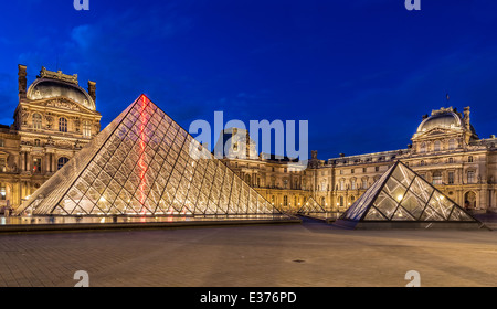 The Louvre, Paris, at twilight, one of the major tourist attractions in France and in Europe - Stock Photo