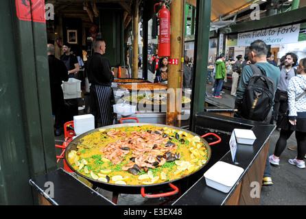 Paella Spanish fast food stall at London Borough Market UK - Stock Photo