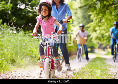 Multi Generation African American Family On Cycle Ride - Stock Photo