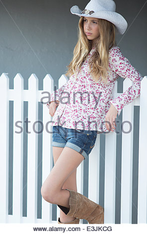 Teenage Girl Side On Wearing Black Leggings Stock Photo