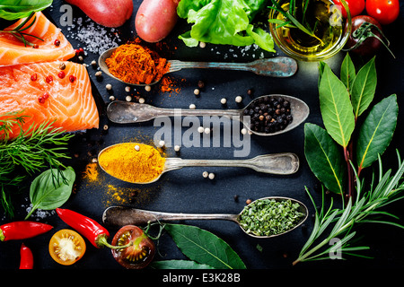 Delicious portion of fresh salmon fillet with aromatic herbs, spices and vegetables - healthy food, diet or cooking - Stock Photo