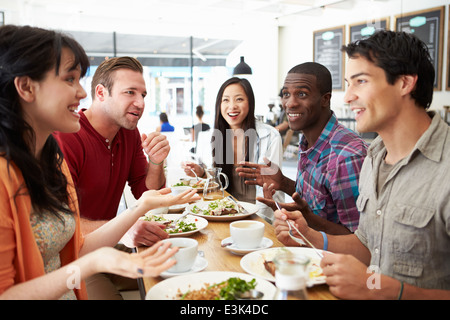 Group Of Friends Meeting For Lunch In Coffee Shop - Stock Photo