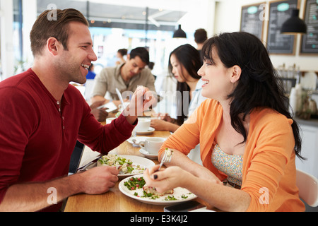 Couple Meeting For Lunch In Busy Café - Stock Photo