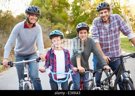 Portrait Of Family On Cycle Ride In Countryside - Stock Photo