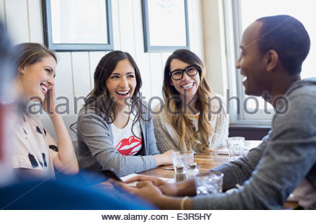 Friends talking at bistro - Stock Photo
