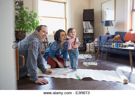 Young couple drawing in living room - Stock Photo