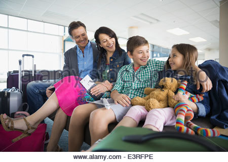 Family waiting in airport - Stock Photo