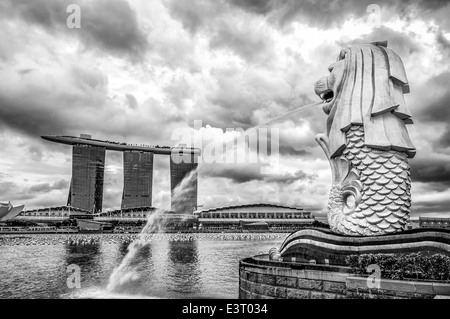The Merlion fountain and Marina Bay Sands Hotel in Singapore in the early evening. - Stock Photo