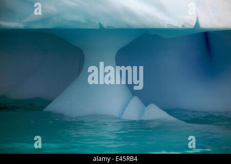 Iceberg showing wave erosion, Antarctica, January - Stock Photo