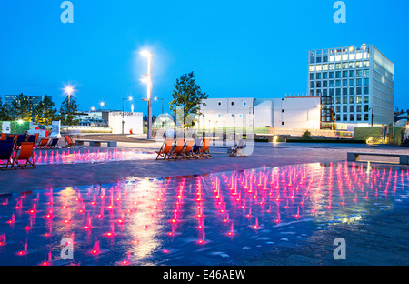 Coloured Fountain Lights At Night Granary Square Kings Cross London UK - Stock Photo