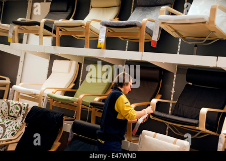 an ikea employee at work stock photo royalty free image 36477431 alamy. Black Bedroom Furniture Sets. Home Design Ideas