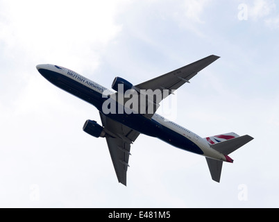 British  Airways Boeing 777-236 (ER) Airliner G-VIIO Departing London Gatwick Airport West Sussex England United - Stock Photo