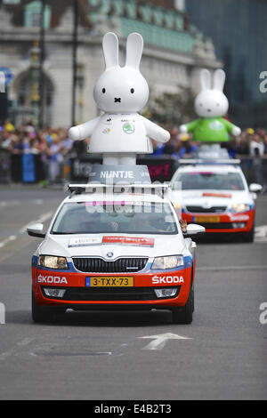 London, UK. 7th July, 2014. Two Tour de France publicity vehicles featuring figurines of Miffy (a Dutch rabbit that - Stock Photo