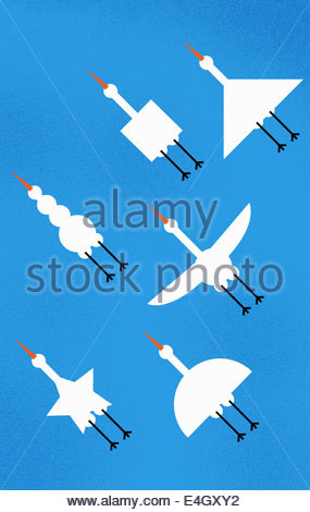 Various shaped birds flying in formation - Stock Photo