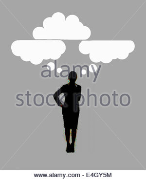 Cloud thought bubbles above pensive businesswoman - Stockfoto