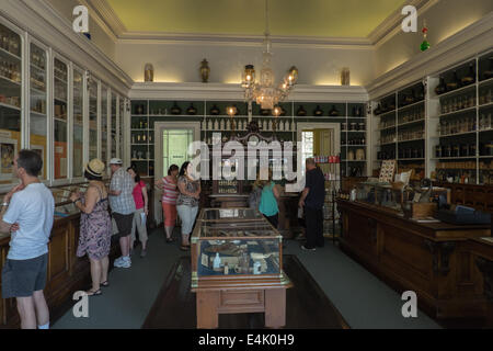 Tourists view artifacts on display in the Niagara Apothecary Museum in the historic old town of Niagara-on-the-Lake, - Stock Photo