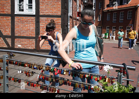 Love locks at Brausebruecke, old harbor quarter, Lueneburg, Lower Saxony, Germany, Europe - Stock Photo