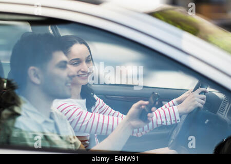 Young couple traveling in car - Stock Photo