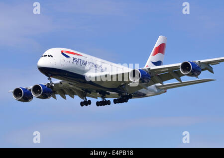 Airbus A380 plane in British Airways colours approaching runway for landing at London Heathrow Airport - Stock Photo