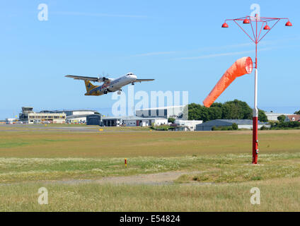 Aurigny new jet taking off from Guernsey Airport - Stock Photo