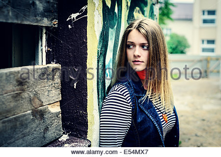 curious woman tries to learn secret looking in uncertainty of darkness - Stockfoto