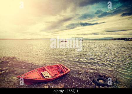 Vintage photo of a little fishing wooden boat - Stock Photo