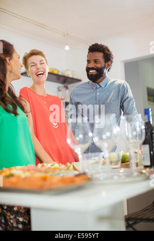 Friends laughing at party - Stockfoto