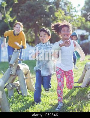 Children running on playground - Stock Photo