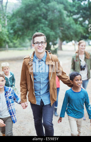 Students and teachers walking outdoors - Stock Photo