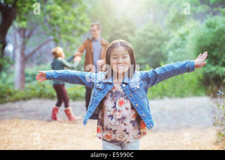 Girl cheering in forest - Stockfoto