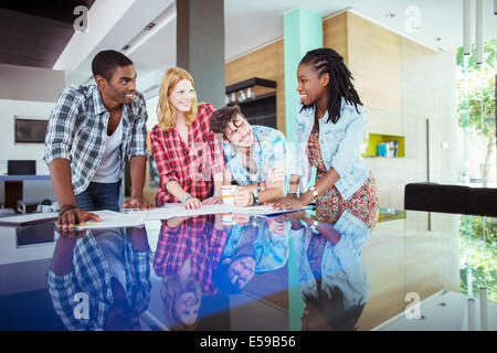 People working together at conference table in office - Stock Photo