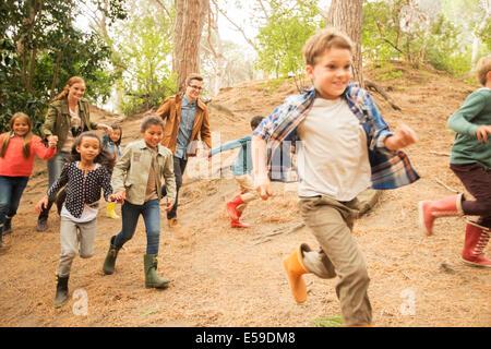 Children running in forest - Stock Photo