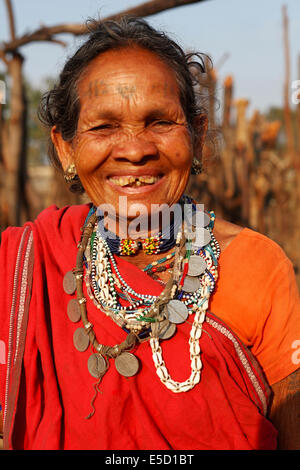 Portrait of a tribal woman wearing traditional jewellery. Baiga tribe. Karangra Village, Chattisgadh, India - Stock Photo