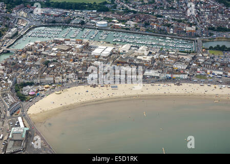 A wide aerial view of the beach at Weymouth showing the town and marina in Dorset, UK. - Stock Photo
