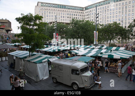 The forecourt of The Royal Festival Hall with the weekend food market. - Stock Photo