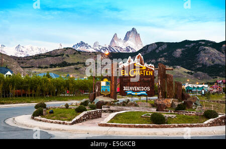 Welcome to El Chalten village sign. Fitz Roy mountain range in the background, Argentina. - Stock Photo