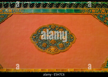 Carved flowers on the red wall of Forbidden City - Stock Photo