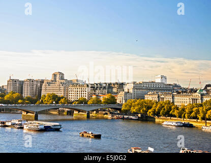 View of the River Thames showing Waterloo Bridge and Shell Mex House, London, England, United Kingdom - Stock Photo