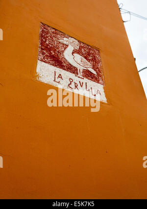 La Grulla: Pictographic Street Sign in Merida. A picture of a crane bird identifies a street in Merida - Stock Photo