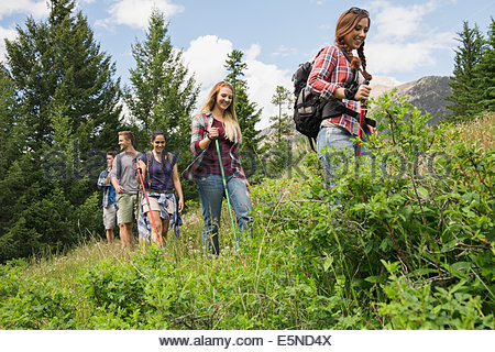 Friends hiking on trail - Stock Photo