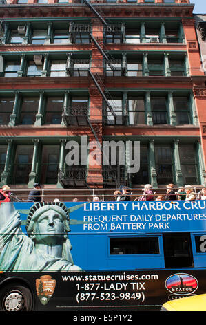 Fire Escape and Tour bus with tourists sightseeing in New York City, NYC. , Tribeca, Manhattan, New York City, New - Stock Photo