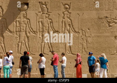 Carvings on the outside wall of the Temple of Hathor, Dendera necropolis, Qena, Nile Valley, Egypt, North Africa, - Stock Photo
