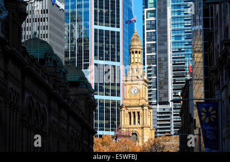 Contrasts between traditional sandstone architecture of Sydney's Town Hall and the modern skyscrapers behind. Sydney, - Stock Photo